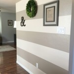 after painted wall stripes decor with boxwood