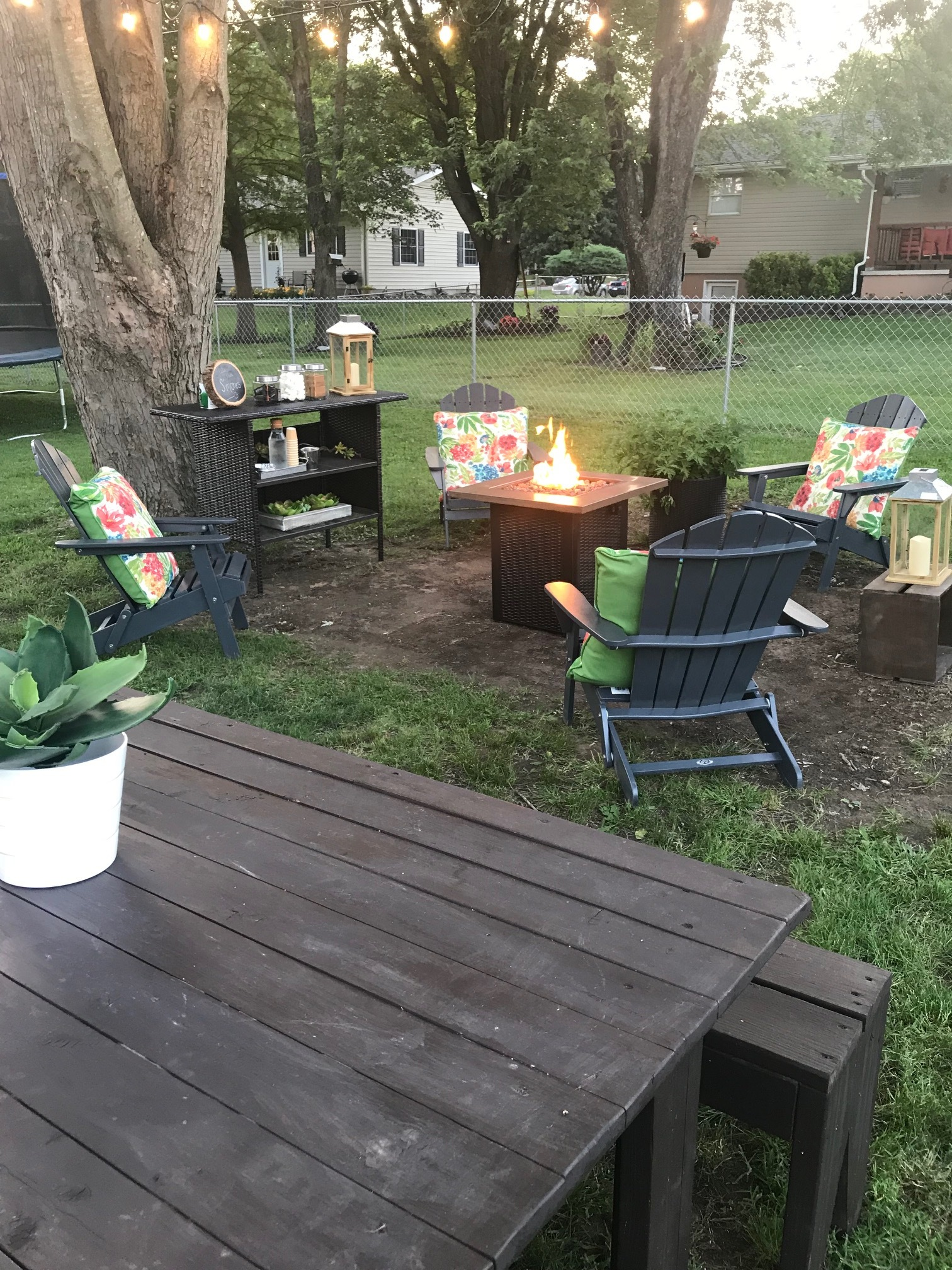 How to hang outdoor string lights. Create an outdoor oasis in your backyard for summer.