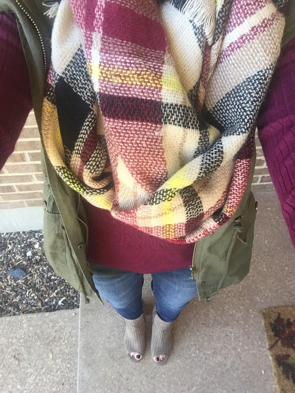 Plaid Blanket Scarf with maroon shirt.