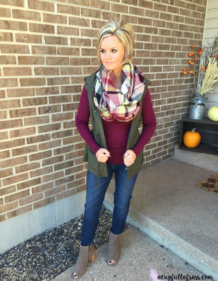 Thanksgiving Outfit Ideas. Maroon shirt with plaid blanket scarf.