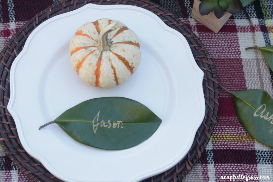 Thanksgiving Table Ideas with Leaf Place Cards. DIY Leaf Place Cards for Thanksgiving. These Magnolia leaves added the perfect touch. I think Joanna Gaines would approve - A Cup Full of Sass