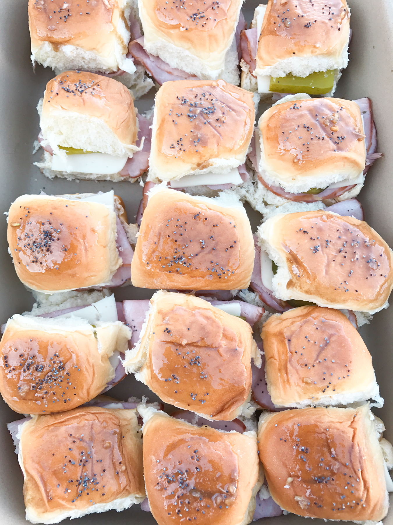 Cuban Sliders - These bite-sized sliders are filled with ham, swiss cheese and pickles on slider Hawaiian buns.