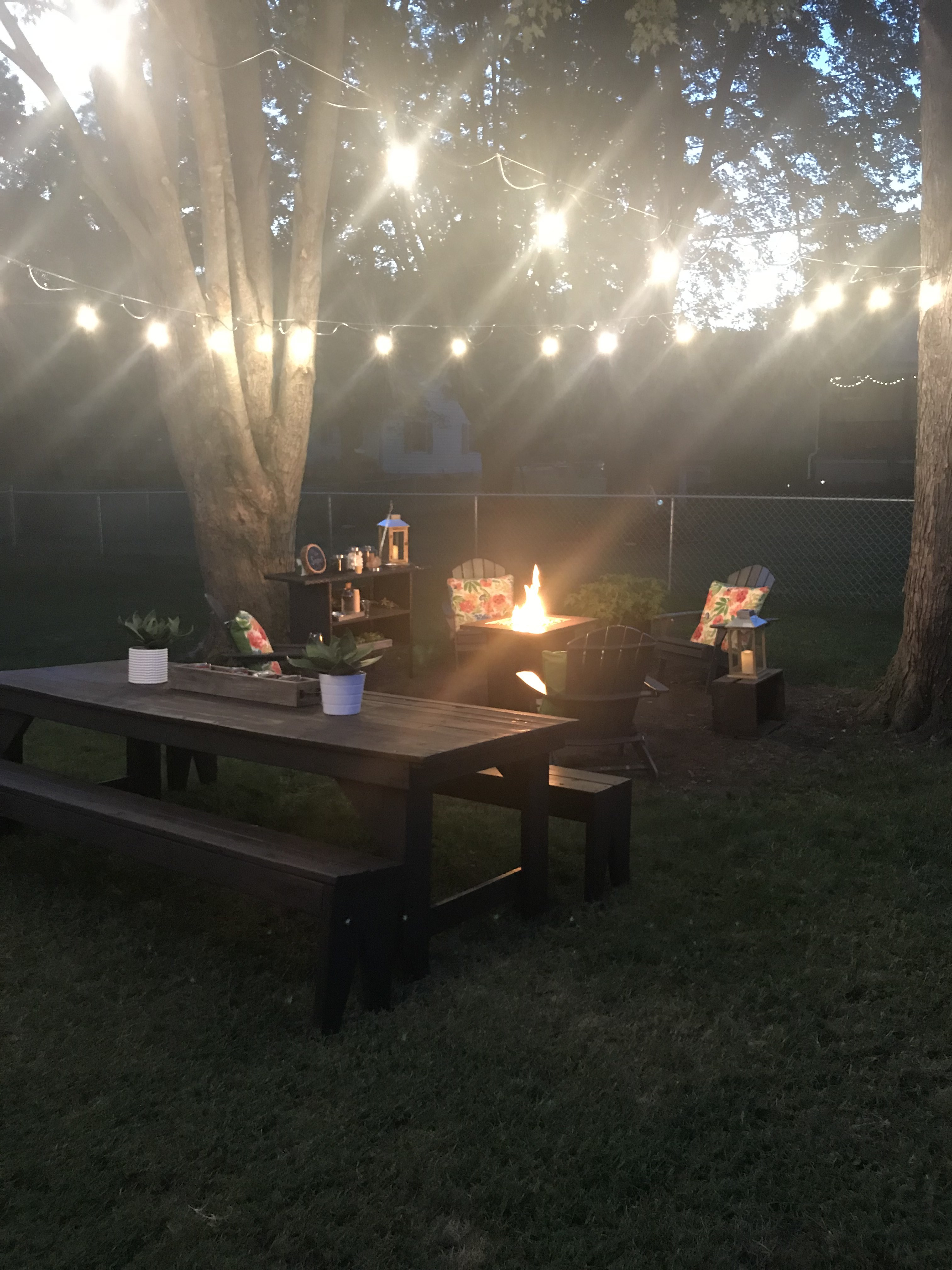 How to hang outdoor string lights. Easy Backyard DIY ideas.