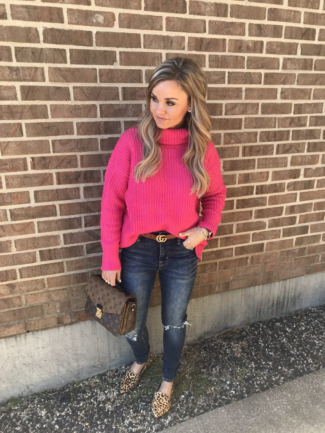 Casual outfit for transitioning to spring. Hot Pink Sweater with high waisted jeans and leopard flats.