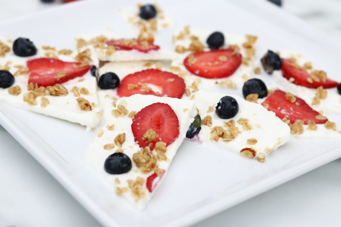 Frozen Yogurt Bark with Fruit. Strawberries, blueberries and granola make this a healthy treat.