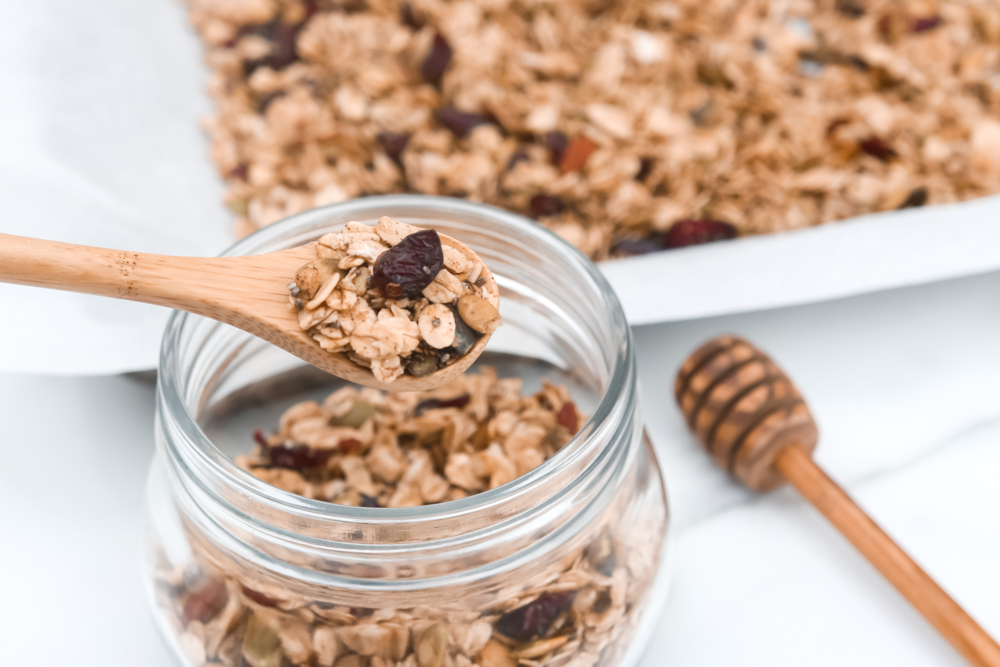 Easy Homemade Healthy Granola. A combination of oats, nuts, seeds, cranberries, vanilla, cinnamon, and maple syrup.