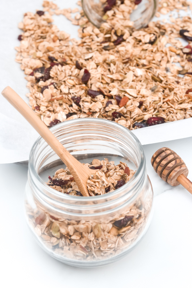 Easy Homemade Healthy Granola. Full of oats, nuts, cranberries, vanilla, cinnamon, and maple syrup.